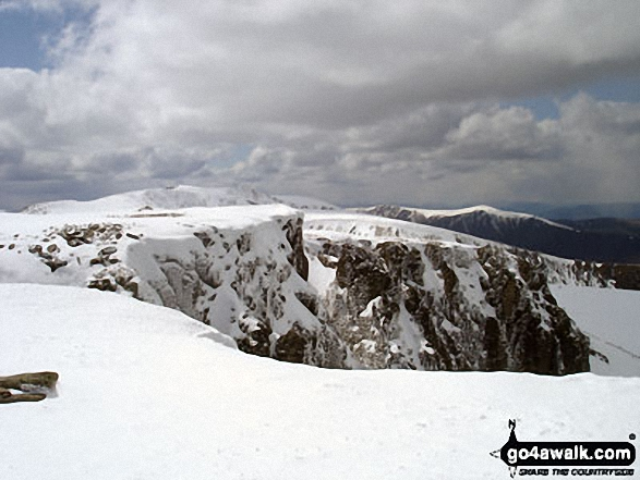 Cairn Lochan (and Braeriach (Braigh Riabhach) (left) and Sron na Lairige (right) in the distance) from Fiacaill Choire an t-Sneachda at the top of the Fiacaill Buttress Taken on a sunny and snowy 6th May, 2012