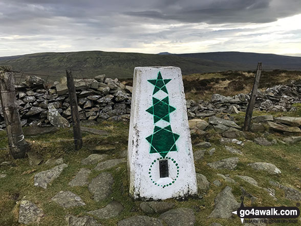 The trig point on the summit of Calf Top