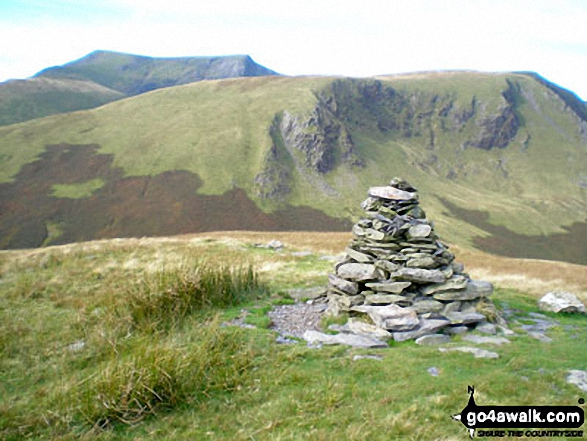 Souther Fell summit cairn with Blencathra (or Saddleback) (distance) and Bannerdale Crags in the background
