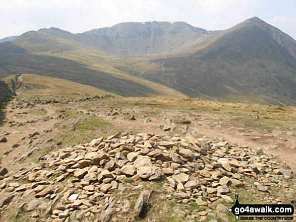 Birkhouse Moor summit cairn - with Striding Edge, Helvellyn, Swirral Edge and Catstye Cam beyond