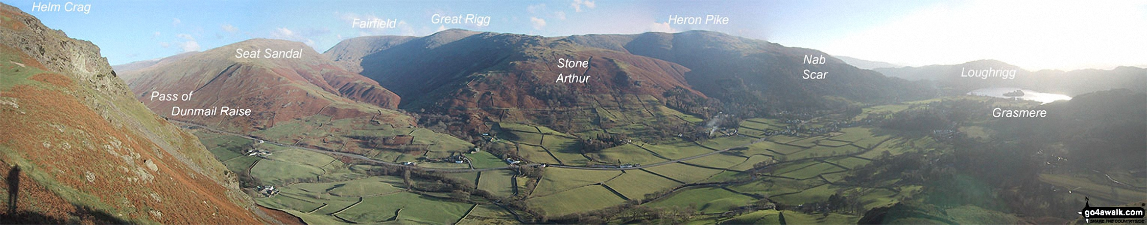 Helm Crag, Seat Sandal,  Grisedale Hause, Fairfield, Great Rigg, Stone Arthur, Heron Crag, Nab Scar, Loughrigg and Grasmere above The Pass of Dunmail Raise from the top of High Raven Crag