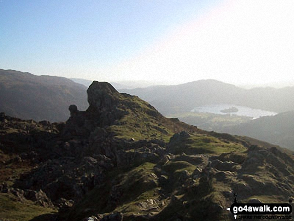 The Howitzer and the Lion and the Lamb on the summit of Helm Crag with Loughrigg and Grasmere in the background