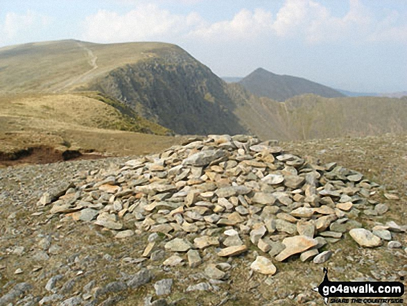 Walk c192 Helvellyn Ridge from Glenridding - Nethermost Pike summit cairn with Helvellyn and Catstye Cam beyond