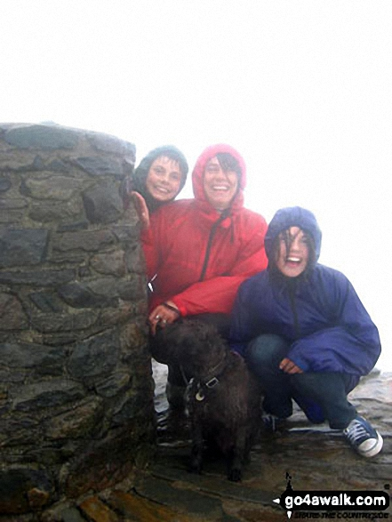 Jane, Holly, William and Gnasher Bishop on the top of Snowdon. Walk route map gw158 Snowdon, Moel Cynghorion, Foel Gron and Moel Eilio from Llanberis photo
