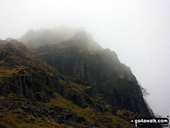 A misty Blea Crag on the descent down from Blea Rigg