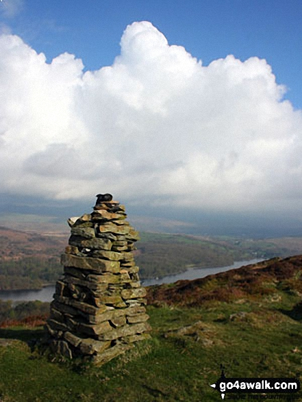 Looking northwest across Brock Barrow's second cairn to the Coniston and Furness Fells hidden beneath towering cumulus