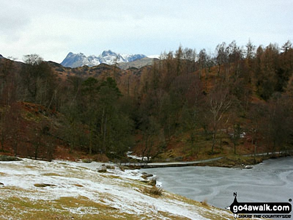 The Langdale Pikes from a frozen Tarn Hows