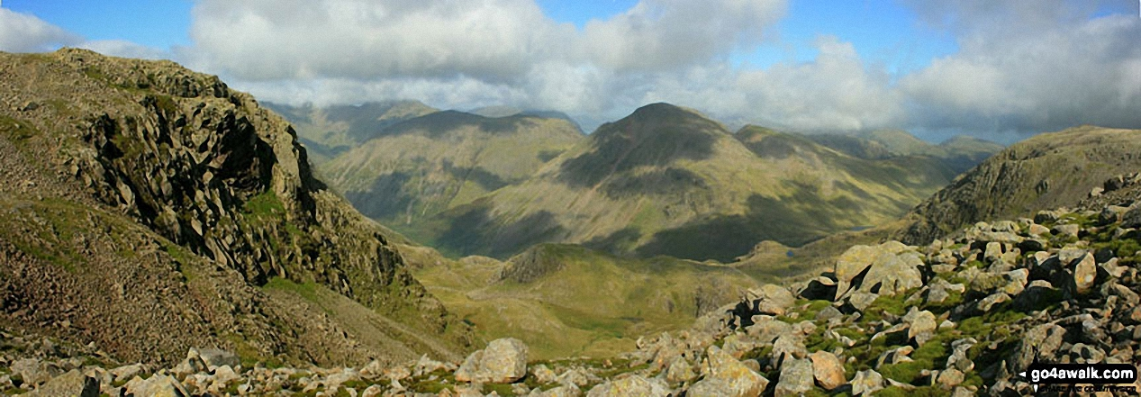 A grand view overlooking the valley of upper Wasdale from Esk Hause with Pillar, Kirk Fell, Great Gable and Green Gable taking centre stage