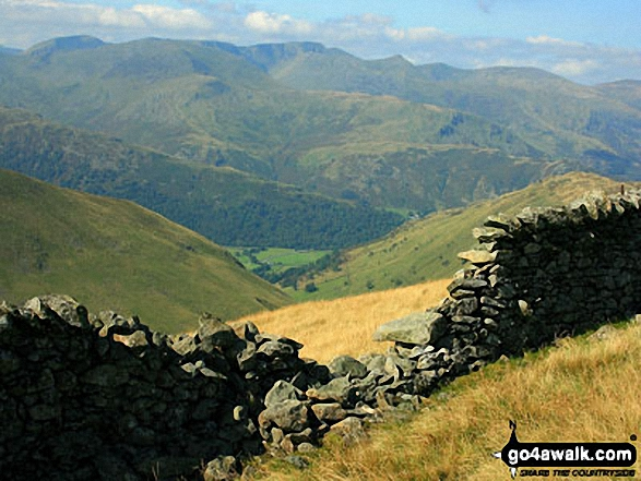 A break in the wall offers this view down towards Hartsop from the Straits of Riggindale