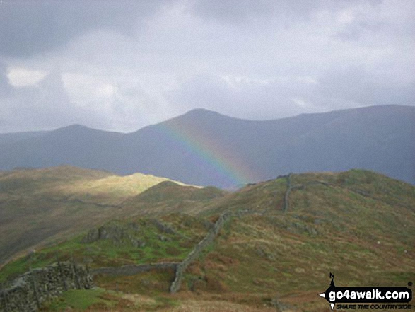 Looking north to Baystones with Thornthwaite Crag (left) and Ill Bell (centre) beyond from Wansfell Pike as the sun catches a passing shower. Walk route map c455 Wansfell Pike from Ambleside photo