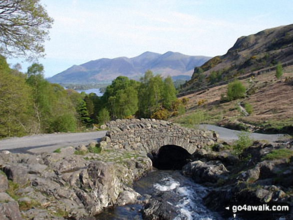 Ashness Bridge over Barrow Beck with Skiddaw in the distance