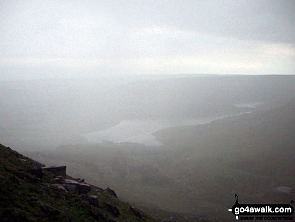 Dovestone Reservoir appearing through the mist from Stable Stones Brow (Hoarstone Edge)