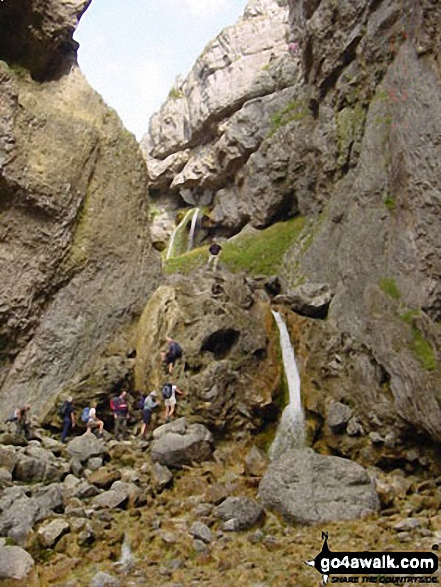 Climbing Gordale Scar nr Malham Cove