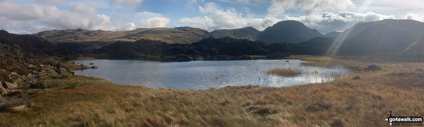 Innominate Tarn with Grey Knotts, Brandreth, Green Gable, Great Gable and Kirk Fell forming the backdrop