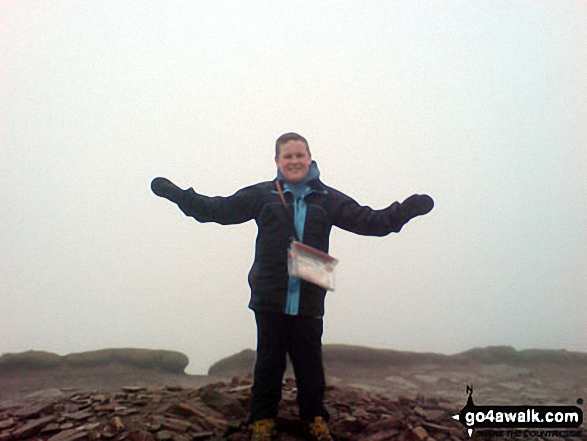 My 12 year old son on Pen y Fan. Walk route map po158 Pen y Fan from The Storey Arms Outdoor Centre photo