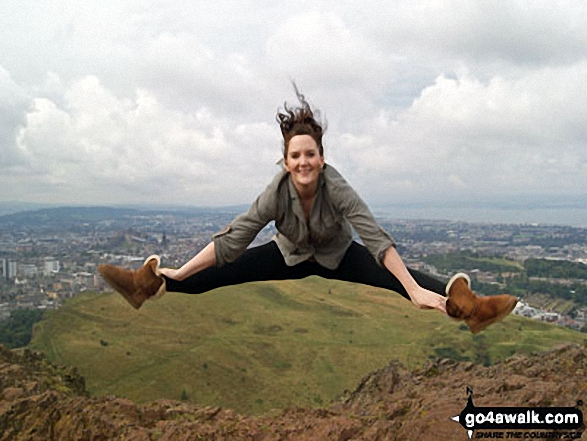 Me jumping for joy at the great view from at Arthur's Seat, Edinburgh, with Edinburgh Castle in the background