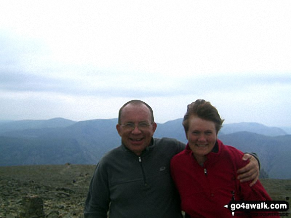 Me and my wife Sue at the summit of Scafell Pike. Walk route map c370 Scafell Pike from Seathwaite photo