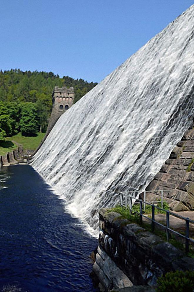 Water cascading over Howden Reservoir Dam