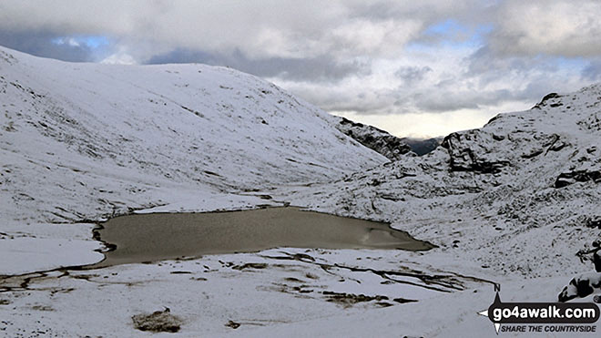 Sty Head Tarn with Base Brown beyond in the snow