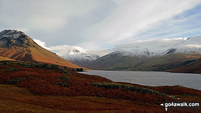 Snow capping Yewbarrow (left) Great Gable (centre) Lingmell and Scafell Pike surround Wast Water from near Overbeck Bridge, Wasdale