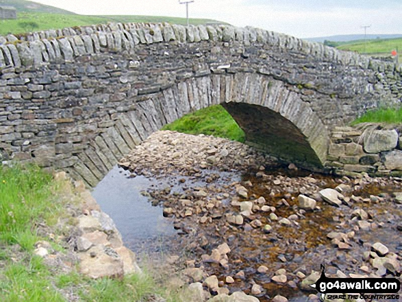 Stone bridge over Whitsundale Beck near Ravenseat. Walk route map ny145 Tan Hill and Robert's Seat from Keld photo