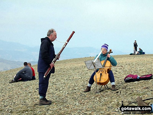 Walk c224 Helvellyn via Swirral Edge and Raise from Glenridding - Musicians on the summit of Helvellyn