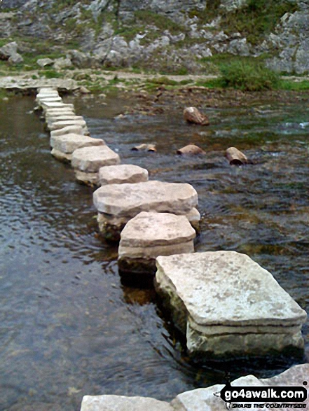 Stepping Stones across the River Dove in Dove Dale. Walk route map s109 Dove Dale and Wetton from Ilam photo
