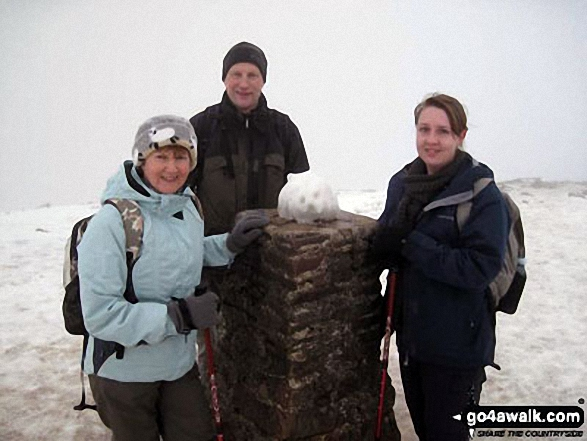 Bryan, Lorna and Ami Goodfellow on the summit of Pen-y-Ghent in the snow
