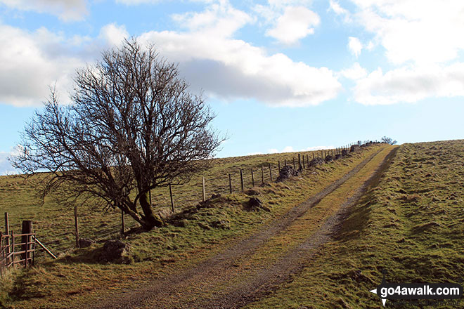 Climbing onto Longstone Moor