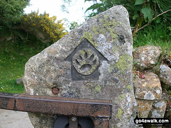 Waymarker for The Tarka Trail on a gate post South of Belstone