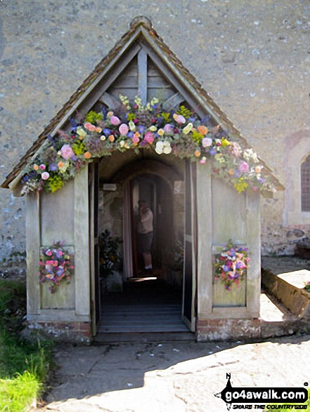 Entrance to Clayton Church bedecked in flowers