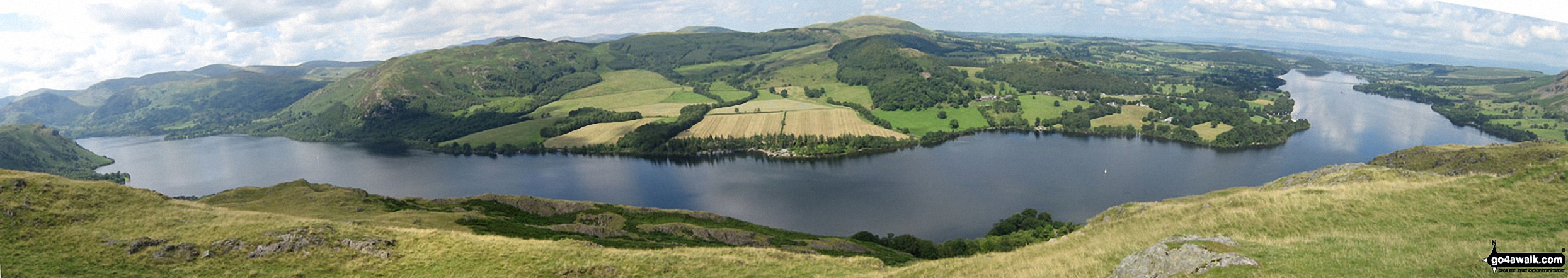 Ullswater featuring Patterdale & Glenridding (left), Gowbarrow Fell (Airy Crag) (centre left), Great Mell Fell (centre), Little Mell Fell (centre right) and Pooley Bridge (right) from Hallin Fell summit