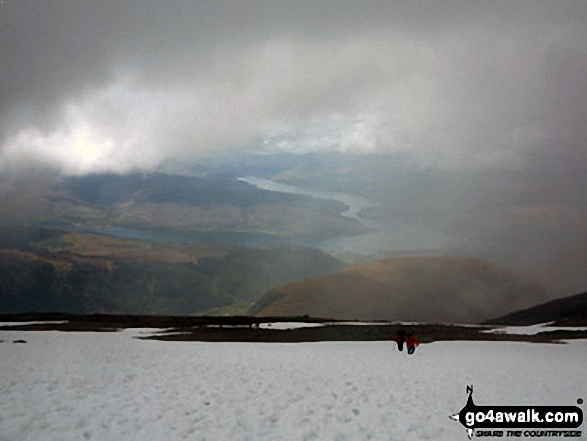 Loch Linnhe appearing out of the mist from the top of Ben Nevis. Walk route map h154 Ben Nevis and Carn Mor Dearg from The Nevis Range Mountain Gondola photo