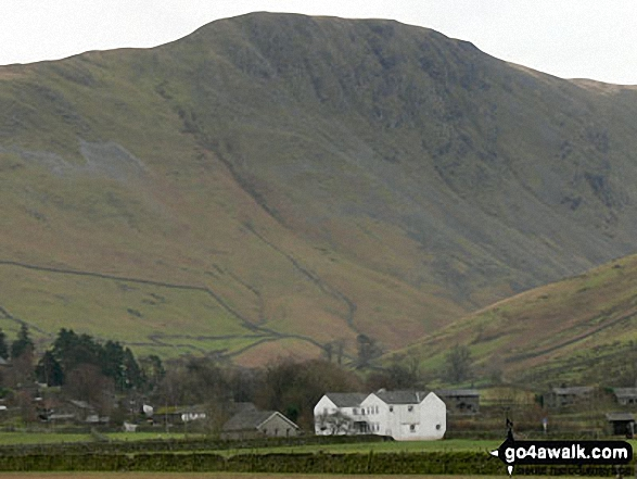 Hartsop Village with Grey Crag towering beyond from the shores of Brothers Water. Walk route map c312 Red Screes from Brothers Water photo