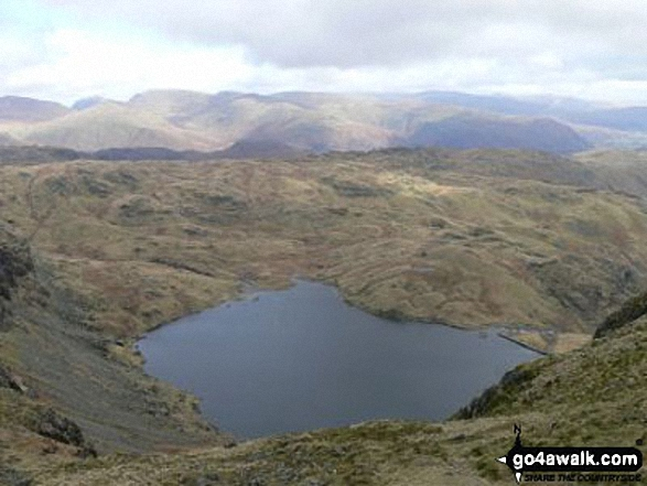 Stickle Tarn from Harrison Stickle. Walk route map c281 The Langdale Pikes via North Rake from The New Dungeon Ghyll, Great Langdale photo
