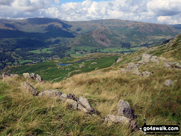 Looking down to Alcock Tarn from near Heron Pike with Helm Crag, Gibson Knott and Steel Fell beyond