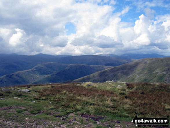 The Central Fells and Seat Sandal (right) from the summit of Fairfield. Walk route map c247 The Fairfield Horseshoe from Ambleside photo