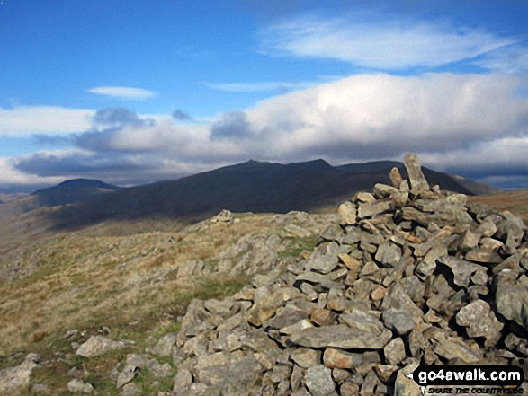 White Maiden summit cairn with Grey Friar (left), Dow Crag, Brown Pike and The Old Man of Coniston (right) in the background