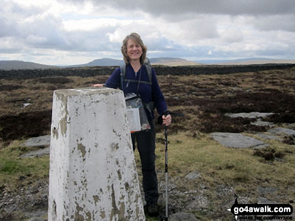 Standing beside the summit trig point on Firth Fell
