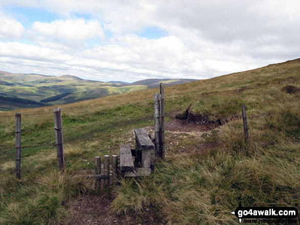 Stile over the border fence between England and Scotland on the way to Windy Gyle. Walk route map n157 Swineside Law and Windy Gyle from Wedder Leap, Barrowburn photo