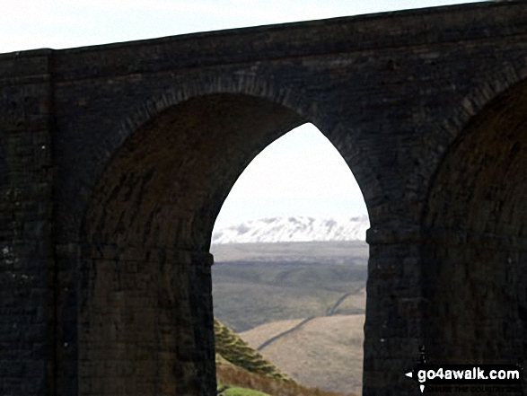 A snowy Whernside though Arten Gill Viaduct