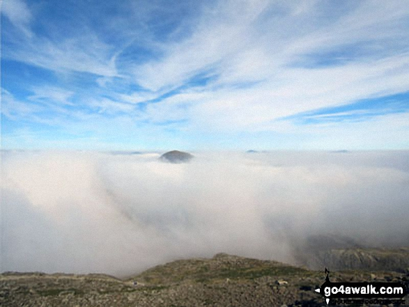 Great Gable peeping up through the clouds during a cloud inversion from Scafell Pike. Walk route map c454 Scafell Pike via The Corridor Route from Seathwaite photo