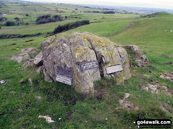 The boulder with memorial plaques on Caermote Hill summit