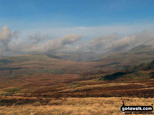 Clouds over the higher fells looking back towards Boot from Great Worm Crag