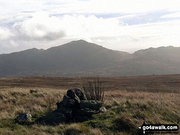 Smaller and slightly higher summit cairn on Great Worm Crag with Caw (Dunnerdale Fells) in the distance