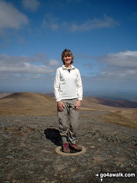 Standing on the Ordnance Survey Concrete Ring on the summit of Blencathra or Saddleback (Hallsfell Top)