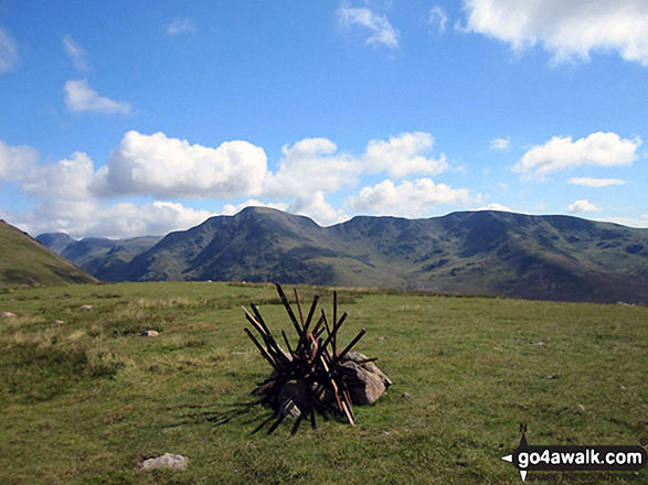 The cairn and tangle of old fence posts that mark the summit of Little Dodd (Ennerdale)