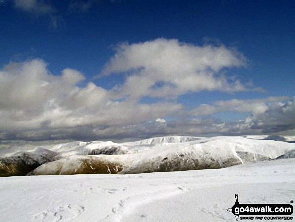 Looking East to the snowy fell tops of Stony Cove Pike (Caudale Moor) and High Street from the summit of Little Hart Crag