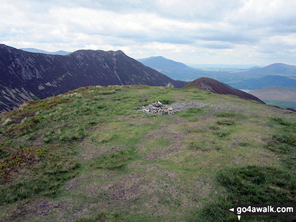 The summit of Ard Crags with the shoulder of Robinson and High Snockrigg beyond. Walk route map c345 Knott Rigg and Ard Crags from Little Town photo