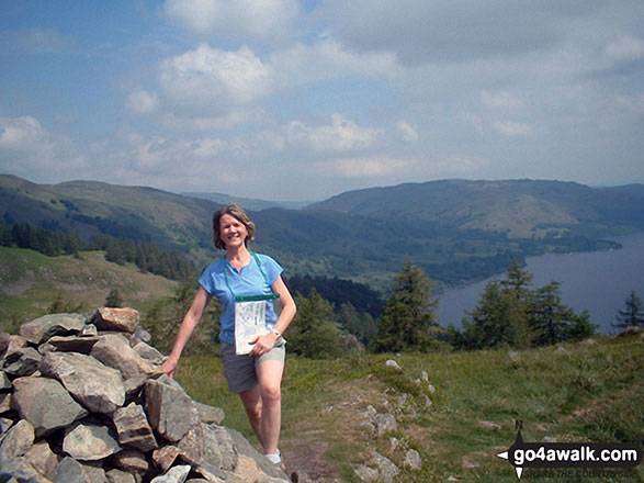 Me by the large cairn on the summit of Glenridding Dodd with Ullswater in the background. Walk route map c192 Helvellyn Ridge from Glenridding photo
